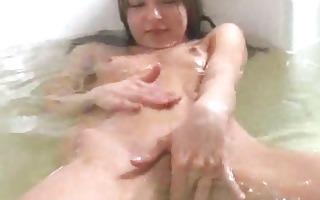 thin girlfriend playing in a baths tube
