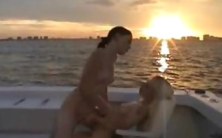2 hawt lesbians making out on a boat