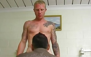 tattooed homosexual hunk lubes up dong