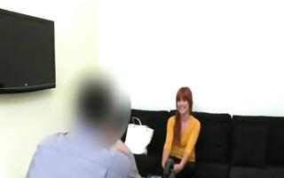 redhead chick teasing on black sofa