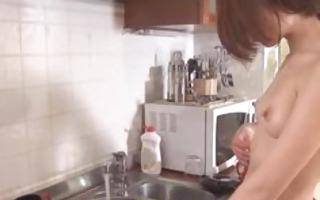 brunette hair honey doing the dishes