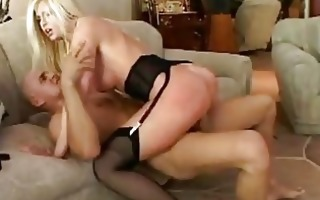 busty blond in black garter thong and nylons
