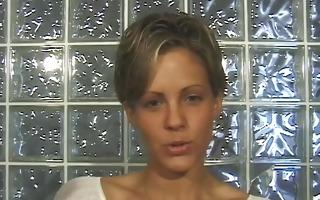 cute brunette in short-cut hair strips on webcam