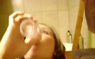 non-professional wench swallowing a glass of jism