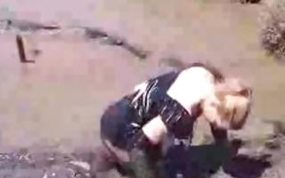 dressed girl overspread in mud