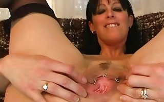 mature amateur spreads her gaping pussy